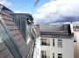 Blick auf Gauben und Terrasse zum Hof